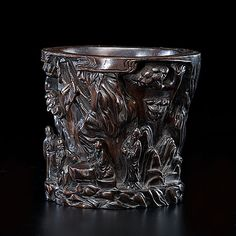Chinese, early 20th century. Zitan wood brush pot, very finely carved in relief to reveal scholars in mountainous terrain; ht. 6 in.