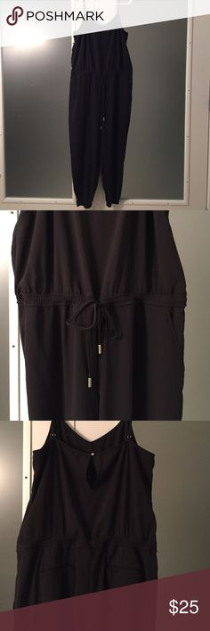 Banana Republic drawstring jumpsuit Lightweight poly material.  Featuring back button closure, drawstring at waist for definition, and elastic at ankle.  Slight v cut along neckline.  Very flattering.  No visible wear or stains. Banana Republic Pants Jumpsuits & Rompers