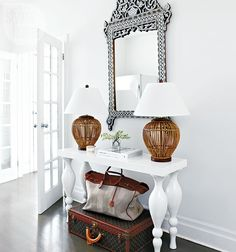 If you don't have space to stow your fancy luggage, why not put it on display in your entryway and use it as extra storage? | Image: Michael Graydon | Design: Montana Burnett