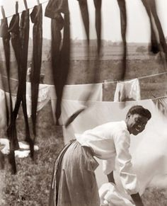 I love this photo, look at that smile! Hanging Laundry c.1902