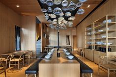 Simple, yet effective ceiling feature - Golucci International Design have designed a second Taiwan Noodle House in Beijing, China.