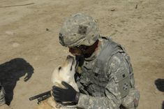 U.S. Army Spc. Harmon, from 1st Battalion, 8th Infantry Regiment, 3rd Brigade, 4th Infantry Division, cuddles with working dog Lucky April 2, 2008, during a break at Combat Outpost Power in Mosul, Iraq.  (U.S. Army photo by Pfc. Sarah De Boise) 4th Infantry Division, Fine Men, Working Dogs, Cuddles, Soldiers, Army, Friends, Animaux, Gi Joe