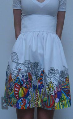 Doodling on white skirt with fabric markers and paint. This looks like a good thing to try with irreversibly stained clothing - in fact I have a white blouse and lots of sharpies - might as well give it a try!