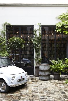 cute cars, crawling plants, bare bulbs and floor-to-ceiling bookcases