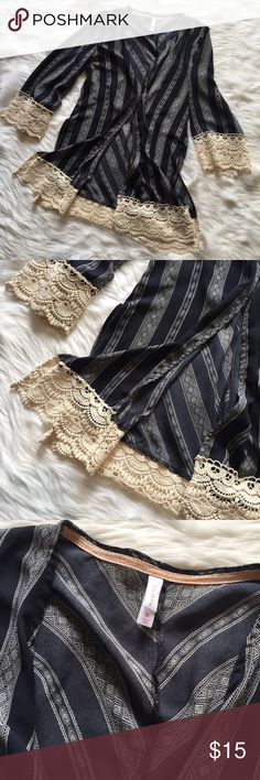 🆕 Xhilaration Lace Trim Kimono Xhilaration Lace Trim Kimono. Blue and ivory print, ivory lace trim. Excellent used condition - no flaws. **Smoke free home. Ask questions. Bundle to save both on shipping and total price. Serious and reasonable offers only (no more than 10% of listing price). Not interested in trades ATM. Sharing is caring!** Xhilaration Tops