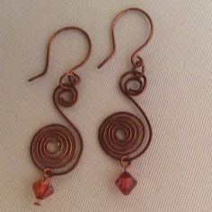 Copper Swirl Earrings These are lovely copper swirl earrings with beautiful orange Swarovski crystals. They will look great with everything. And as is true of all copper these earrings will look more beautiful as they age. Becky Barnes Designs Jewelry Earrings