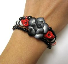 Rockabilly Red Skulls Day of the Dead Bracelet Itty Bitty Pretty Sugar Skull Jewelry Black Rose. $13.99, via Etsy.