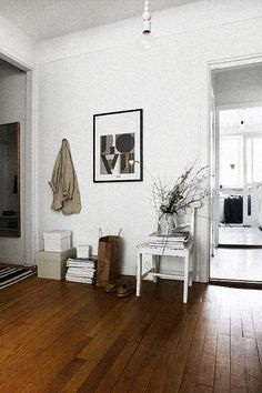 simple white walls with rich floors,this combination will show case my art perfectly!