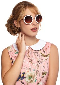 The Music Seen Sunglasses in White. You love seeing your favorite records come to life on the festival stage, and thanks to these round sunglasses, you wont have to squint to see what happens during the mid-afternoon show. #white #modcloth