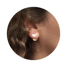 This combination includes a hammered half moon stud that measures 5 mm by 1 cm and a half moon peekaboo ear jacket that measures 1 cm wide and 12