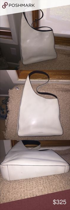 Authentic Prada ivory shoulder bag Authentic Prada shoulder bag. Used but in good condition. Bought in Saks 5th ave, Beverly Hills. Prada Bags Shoulder Bags
