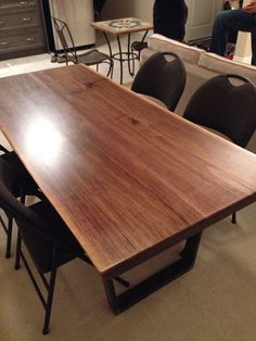 FAV table. maybe a bit darker, and glass? like dark metal base w obtuse angles on floor