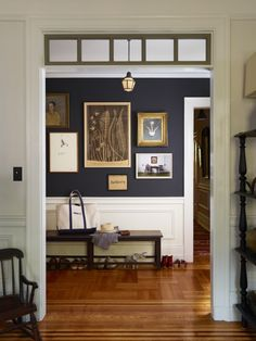 "Entryway featuring gallery art display and walls painted ""Off Black"" by Farrow & Ball (via Remodelista) 
