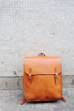 Hand-Stitched Carry on bag with good quality vegetable tanned cow leather - With 2 small pocket at the front of bag  - Adjustable strap  - Can carry A4 documents and 13 inch notebook*  - Stylish and special  - UNISEX  - Approx. dimension: 32cm (L)X 40cm (H)X13cm (D)    * Notebook size may be various. To avoid any misunderstanding, please check with me for your specific notebook dimension. :)    For the leather color example, please go to below listing…