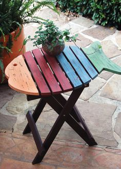 folding fish table  multicolored $75.00 This would probably be easy to make with old pallets too.