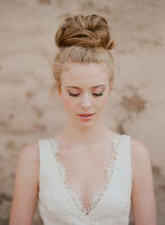 v-neck lace wedding dress w/ messy bun hair style