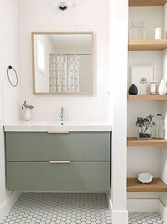 The guest bathroom utilizes a simple Ikea vanity custom painted to the perfect shade of green and features leather hardware from the Australian company Made Measure. Mid Century Modern Bathroom, Floating Bathroom Vanities, Simple House, Green Bathroom, Bathroom Trends, Ikea Vanity, Guest Bathroom Small, Simple Bathroom, Bathroom Design