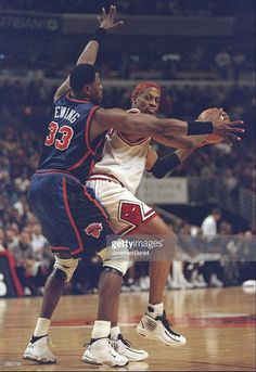 9 Dec 1997: Forward Dennis Rodman of the Chicago Bulls moves the ball as  center Patrick Ewing of the New York Knicks covers him during a game at the  United ...