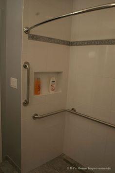 This Universal Design bath remodel is an... outstanding example of aging in place design. The widened doorway with pocket door, open..