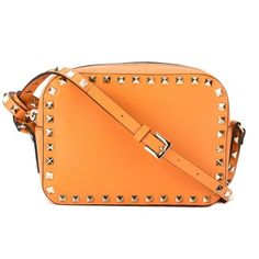 "this is an authentic valentino rockstud camera bag in peach it's crafted in a smooth leather canvas with the signature gold-tone studded trim, adjustable shoulder strap, and foil embossed insignia. the interior has textile lining with one open pocket and a zip closure with pull tab. it's a stylish valentino handbag for a sophisticated yet edgy fashionista. made in italy. this item is new with tags.<table class=""product-import-table""…"