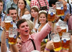 Revellers enjoying themselves at the 180th Oktoberfest. The beer record was set in 2011 when 7.5 million liters were drunk.