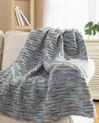 Knit yourself this fabulously easy chunky knit blanket. A size 10 knitting needle and chunky weight yarn is needed to create this great blanket. It'll keep you nice and warm as the chunky yarn is a bit heavier.