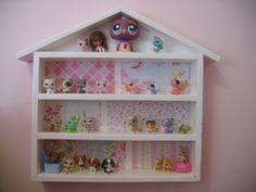 Cute idea, but we would need a half dozen (or so) of them for all her figures.  DIY Littlest Pet Shop House   from www.controllingcraziness.blogspot.com.