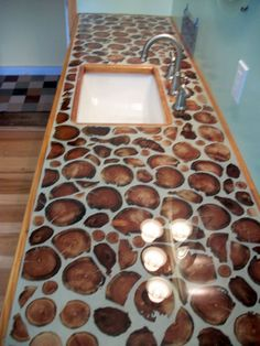 Cordwood countertop: Eastern red cedar slices, grout to set and epoxy to seal. By Bill Jarrett. Very nice. www.cordwoodconstruction.org