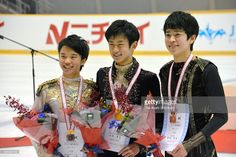 Second place Kazuki Tomono, winner Sota Yamamoto and third place Daichi Miyata pose on the podium at the medal ceremony for the Men's Singles during the All Japan Figure Skating Junior Championships at Kasamatsu Undo Park Ice Skate Center on November 23, 2015 in Hitachinaka, Ibaraki, Japan.