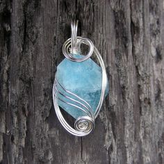 Wire wrapped blue aquamarine pendant. #jewelry