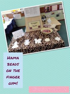 Develop fine motor skills at the finger gym by making patterns with Hama beads.