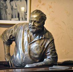 A sculpture of US Nobel Prize in Literature  -  Ernest Hemingway, chilling at the bar in El Floridita, Havana. Sculpture by Cuban artist José Villa Soberón, 2003.