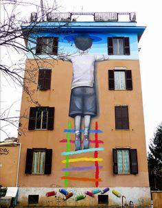 """Julien """"Seth"""" Malland aka Seth Globepainter is an incredibly talented Parisian street artist best known for his large-scale murals of people staring into rainbow-like backdrops.  More street art via Colossal"""
