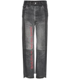 Vetements - Embroidered cotton jeans - Stake a claim in tongue-in-cheek fashion with VETEMENT's black printed cotton jeans. High-rise and loose fitting, these feature the designer's signature approach of re-panelling denim for a one-of-a-kind, urban finish. The front and back are embroidered with some of the brand's now iconic, brash statements. seen @ www.mytheresa.com
