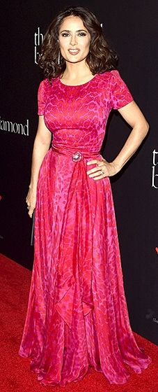 What a waist! Salma Hayek sizzled in a hot pink animal-print gown with a fabric-tie at the waist.