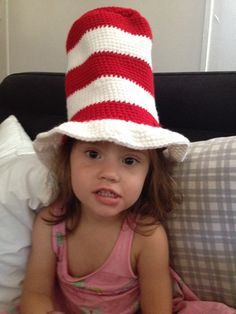Get a cute striped top hat. Red and white stripes just like the one the cat in the hat wears. You can get it in any size-from baby to adult. For
