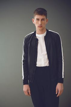 Jörg Strehlau photographs Jannik in a Zara Man bomber jacket with a Michael Sonntag shirt and Goetze pants.