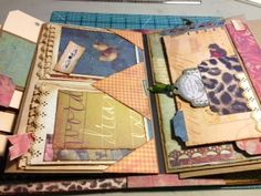 "Book of Memories - Follow the Paper Trail - February 2013 - Ustream tutorial is archieved on her blog (She did 3 versions; this one used a specialty paper ""Scribe"" from K The tutorial also demos her Perfect Hinge."