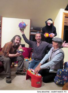 Peter Jackson, Hugo Weaving, Cate Blanchett, and Sir Ian McKellen playing with kid toys during the filming of The Hobbit.