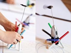 Make a drawbot with a cheap milk frother, markers, and velcro. It's a spirograph robot! A good rainy day activity.