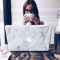 She showing off her Marble MacBook in Montreal's finest coffee shops | www.uniqfind.com | #marblemacbook #uniqfind
