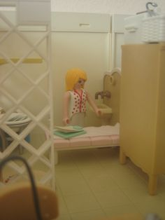 The Doctor on duty washes her hands in the private examination room before her next appointment.