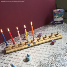 This beautiful and unique handmade ceramic menorah (chanukiah) is one-of-a-kind. Using high-fire stoneware in the hand-built method, I flattened stoneware and created 9 little tiles from the same clay, and formed a menorah. I fired it to bisque and then glazed it with lead free clear glaze and high fired it again in my kiln at my studio. I then glued 9 aluminum candle cup holders and the little birds I created as well to give it a touch of color. Ceramic menorahs by KerenOrHandmade on Etsy