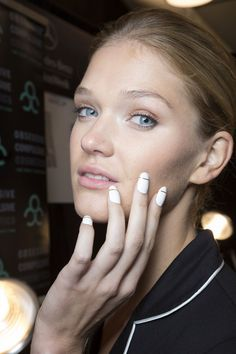 The clean white manicure with a single gold strip (created by manicurist Gina Edwards for Kiss and Broadway Nails) contrasted the ladylike collection at Erin Fetherston.