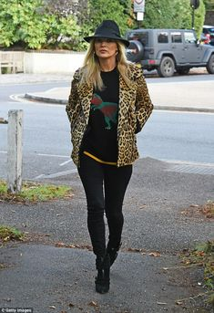Fashion queen: Even for a casual stroll near her London home on Tuesday, Kate Moss made su...