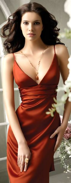This is a beautiful evening date dress!  Love the color! A classy and sexy up do would look amazing! A small clutch or a delicate purse with a gold chain,  bling. ..gorgeous!