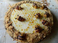 Торт «Медовик. яйца куриные  2 шт.,мед (для теста + для украшения)3 ст.л. + 1 ст.л. сахар (тесто+крем+глазурь)  150 г + 1 ст. + 6 ст.л. масло сливочное (тесто+крем+украш+глазурь)  50 г + 100 г + 100 г + 50 г молоко коровье (тесто+крем+ глазурь)  2 ст.л. + 2 ст. + 1 ст.л. сода  1, 5 ч.л. мука крупа манная  4 ст.л. лимон (сок и цедра)  1 шт. сахарная пудра (для украшения)  100 г какао (для глазури)  1 ч.л. миндаль  10 шт. малина (желтая)  20 шт. гвоздика (сушеная)  20 шт. ром (по желанию)  0,5…