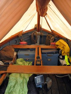 Under the simple tent on a sloop rigged Ilur. Pretty roomy for a 14' hull.