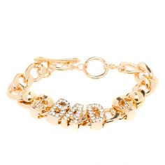 """Who's bad? This tough-glam bracelet is! Match its rhinestone-encrusted """"BAD"""" and skull charms with a navy-blue leather jacket, skinnies and cool floral-print Oxfords. BEAUTY TIP: This piece definitely calls for an oxblood nail polish color."""