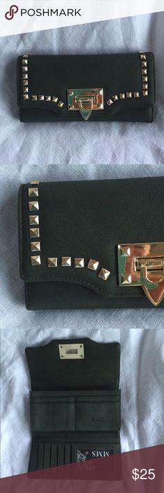 NWT Gold Studded Wallet by MMS. Dark green with gold studded accents, this large wallet by MMS is super stylish and has a rockstar edge. Plenty of compartments for credit cards, cash, change and ID. New, never used. MMS Studio Bags Wallets